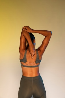 Back view of athlete stretching