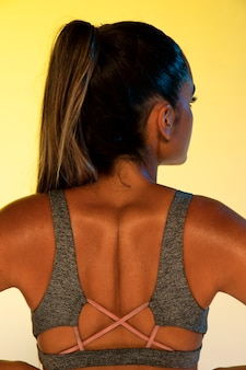 Back view of athlete and yellow background