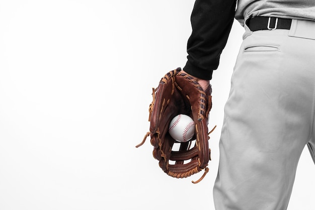 Back view of baseball held in glove