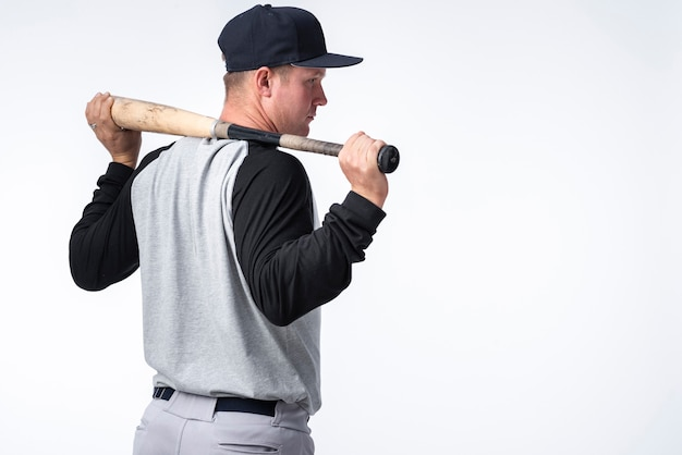 Back view of baseball player with bat