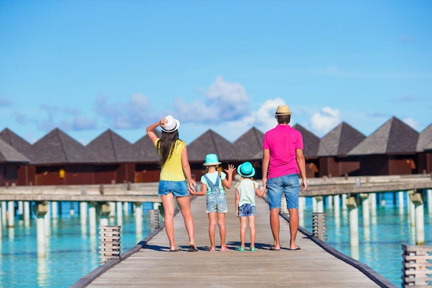 Back view of beautiful family on summer vacation