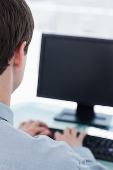 Back view of a businessman using a computer