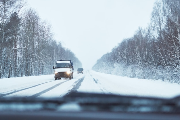 Back view of car on snowy winter road