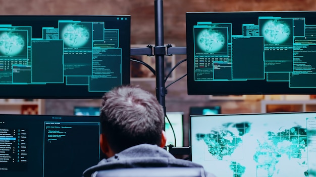 Back view of cyber criminals get access denied while hacking the government.