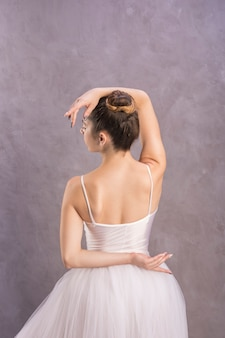 Back view elegant ballet position