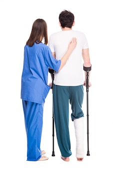 Back view of experienced physician assistant her patient.