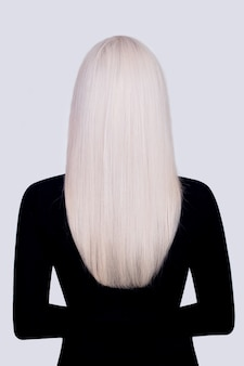 Back view of female long, straight, healthy, blonde hair