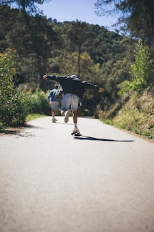 Back view of friends on skateboards