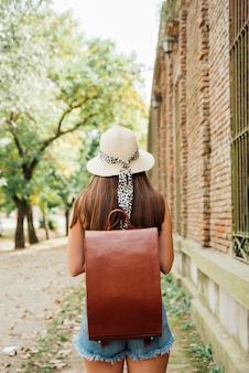 Back view girl with vintage backpack