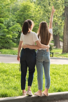 Back view girls posing in the park