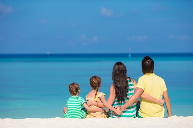 Back view of happy family on summer vacation