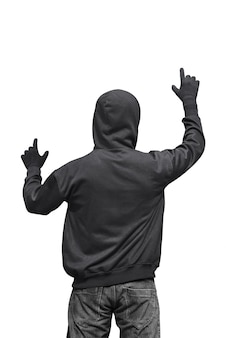 Back view of hooded hacker touching something