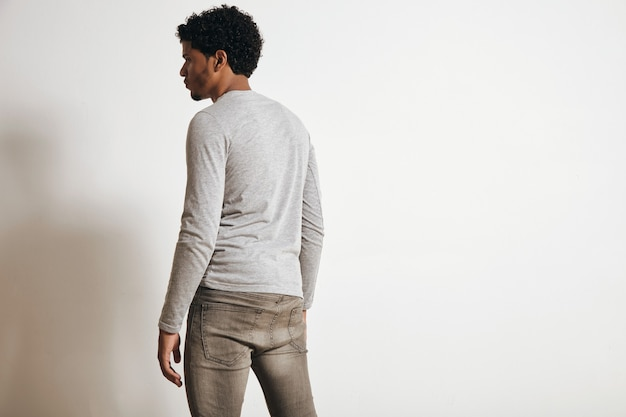Back view of latino man looking on side, isolated on white, wearing blank heather grey clothing