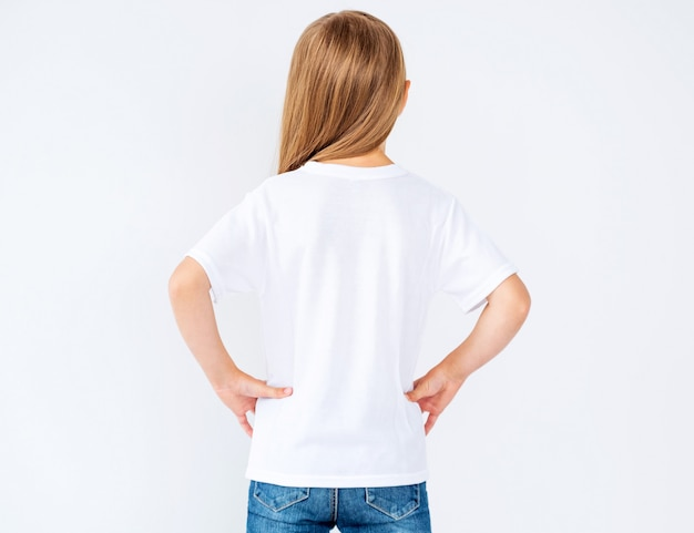 Back view of little girl in blank t-shirt