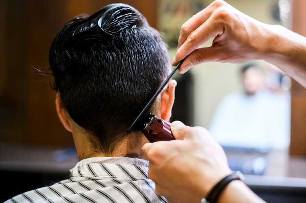 Back view of man getting a cut