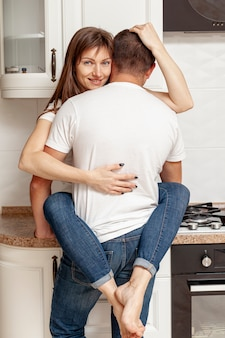 Back view of a man hugging his girlfriend