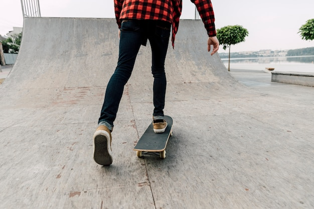 Back view of man on skateboard