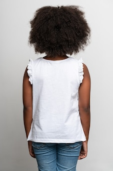 Back view of the multiracial girl wearing white t shirt. childhood concept. isolated on white background, studio shot