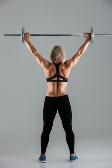Back view of a muscular adult sportswoman