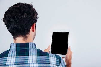 Back view of man with tablet