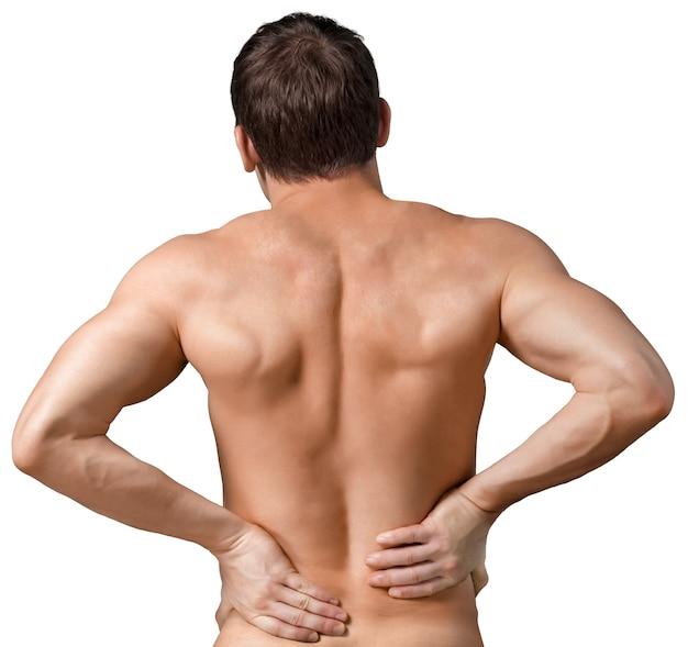 彼の痛む背中に触れる上半身裸の男の背面図