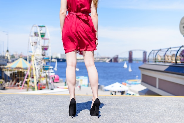 Back view photo of girls legs in highheels nature background