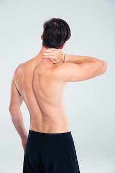 Back view portrait of a man having neck pain isolated