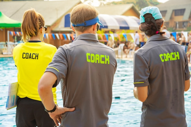 Back view of sport coaches