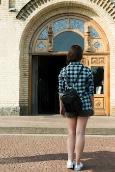 Back view of teenage girl going to school