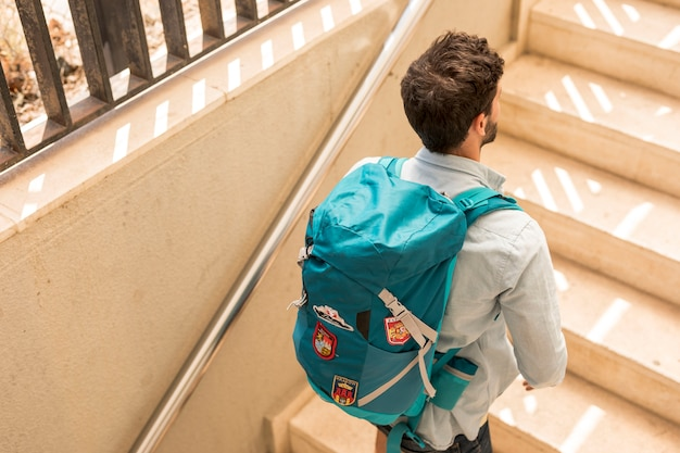 Back view traveler on stairs