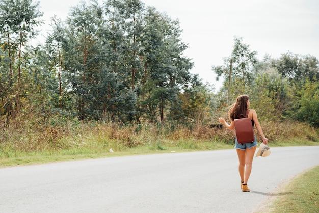 Back view of traveler walking away
