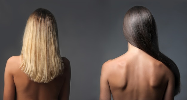 Back view of two woman with blond and black hair