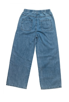 Back view of wide women's summer jeans isolated on a white surface. denim pants.