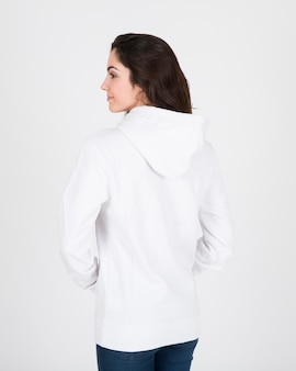 Back view of woman wearing white hoodie