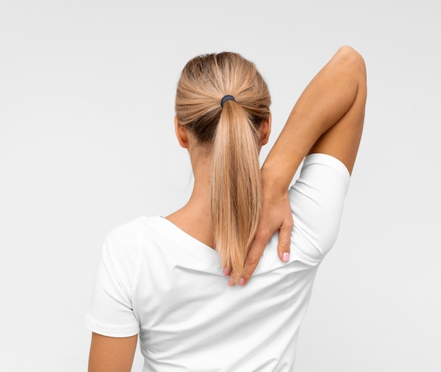 Back view of woman with doing physiotherapy with arms