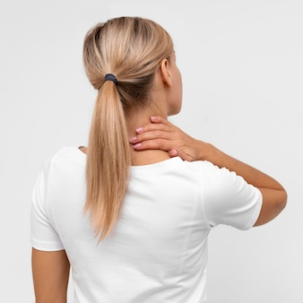 Back view of woman with neck pain