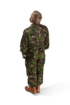 Back of young army soldier wearing camouflage uniform isolated on white studio