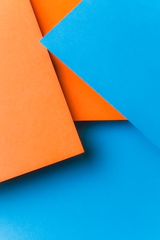 Backdrop of blue and an orange paper