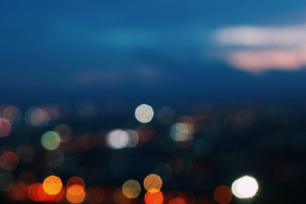The backdrop of the city where blurry lights blur.