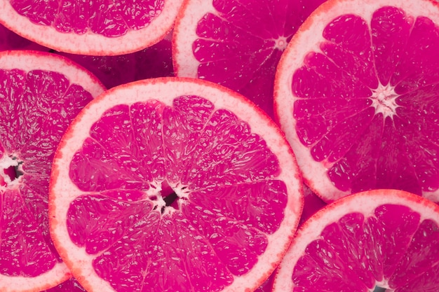 Backdrop of juicy grapefruits slices