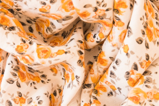 Backdrop of an orange floral fabric