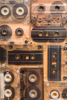 Backdrop of transparent audio cassette tapes