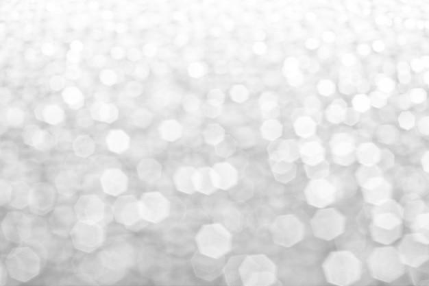 抽象的なシルバーホワイトグリスターの背景のコピースペース光沢のあるぼやけたライト、クリスマスbackgr