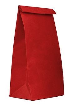 白いbackgroで分離されたコピースペースと赤い紙の買い物袋