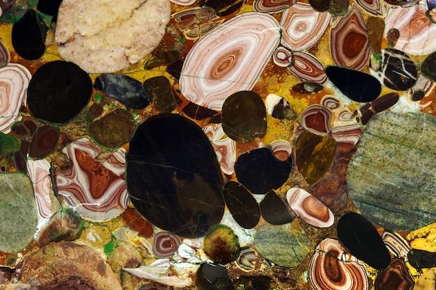 背景-天然のマルチカラーの石、碧玉と瑪瑙の集合体