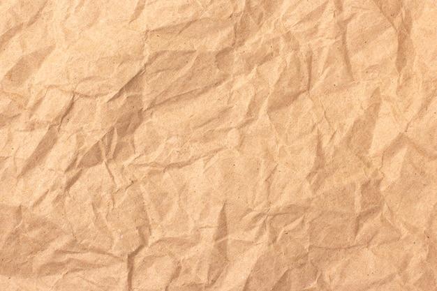 Фон абстрактный текстуры бежевой бумаги