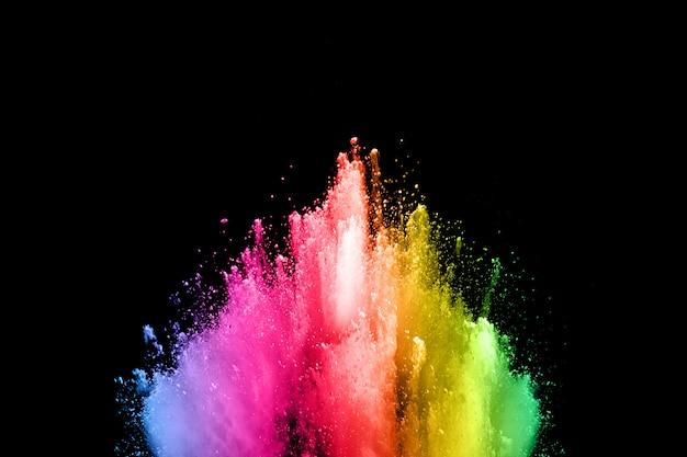 黒background.abstractの抽象的な色粉塵爆発は、背景を飛び散った。