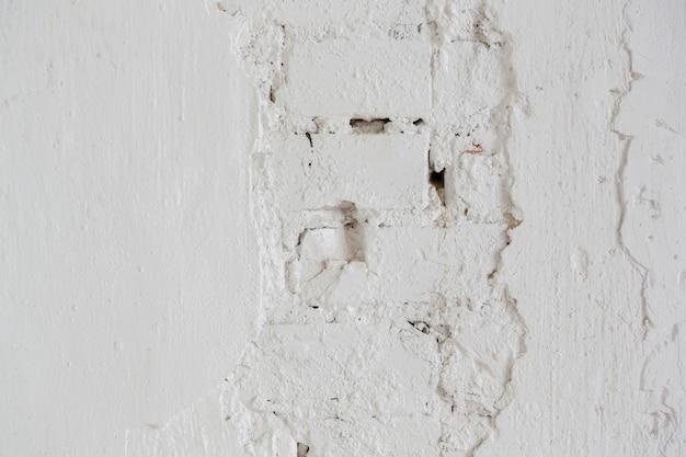 Фон и текстура кирпичной стены, окрашенной краской или шпаклевкой