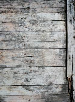 古いひびの入った木の板の背景と質感