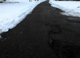 Background asphalt street landscape with snow